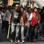 A Summer of Workers' Revolts and Ethnic Divisions in China