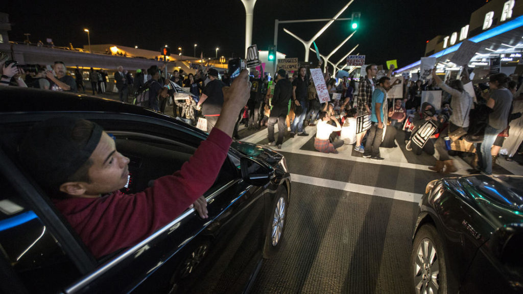 "Demonstrators block the Los Angeles Airport in a bid to free those detained inside by customs officials, January 2017. Photo from the <a href=""http://www.latimes.com/local/lanow/la-me-lax-protest-20170129-story.html"">LA Times</a>."